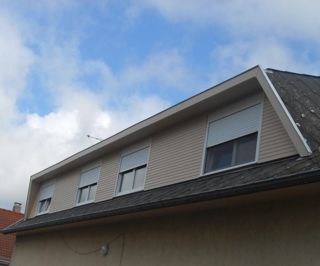 Bardage bois et châssis fenêtres remis à neufs